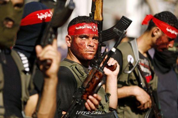 Демонстранты на марше, организованно Демократическим фронтом освобождения Палестины (23 мая 2009 года). REUTERS/Ibraheem Abu Mustafa