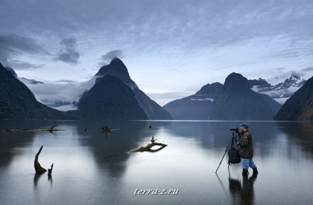 Photographer at Milford Sound, Fiordland National Park, New Zealand