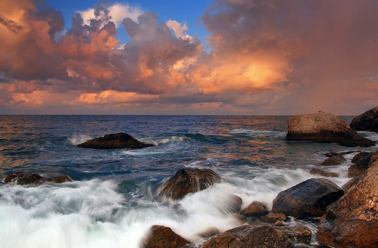 Stormy sunrise on the coast of tropical sea