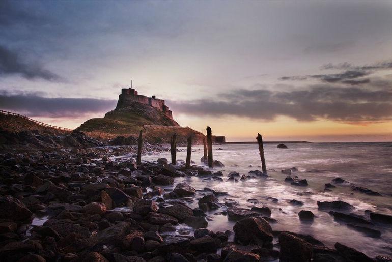 lindisfarne_castle_by_markgphoto-d5me7g2