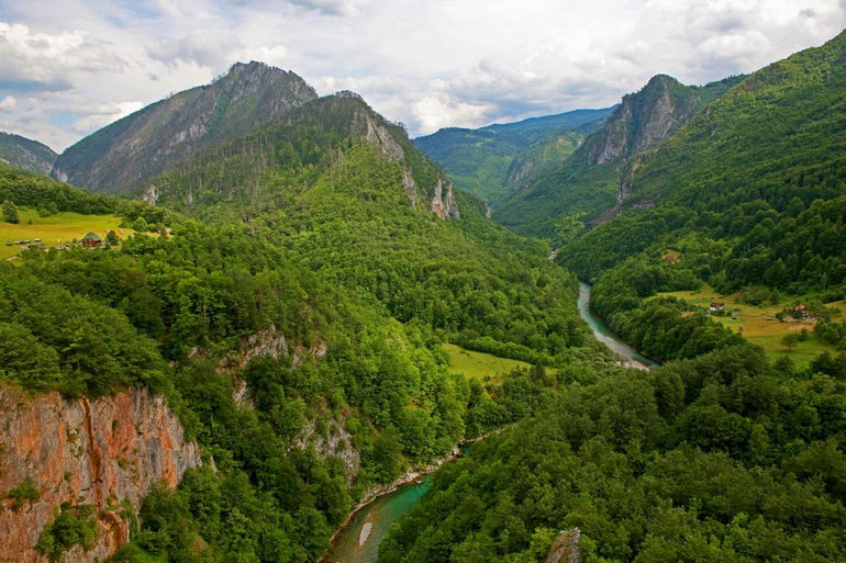 a-beautiful-view-of-the-canyon-of-the-tara-river-with-a-settlement-at-the-bottom-montenegro-1600x1066