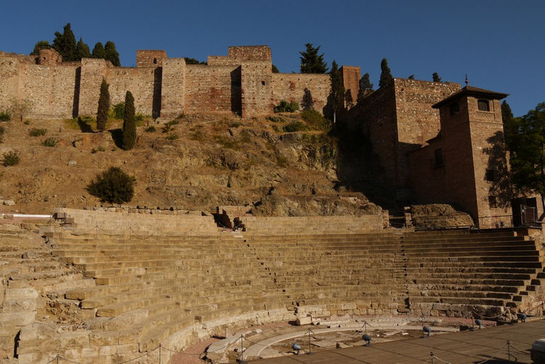 mc3a1laga-spain-5-teatro-romano-with-the-alcazaba-de-mc3a1laga-above-on-the-hill